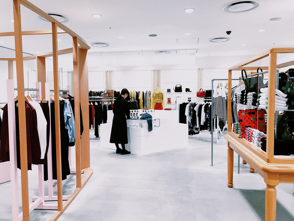 a person shops in-person in a well-lit retail space
